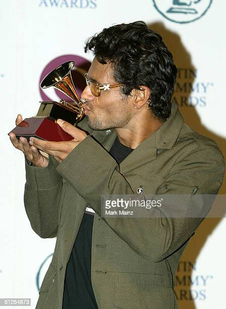 Musician Robi Draco Rosa winner of Best Music Video for Mas Y Mas poses backstage at the 5th Annual Latin Grammy Awards held at the Shrine Auditorium...