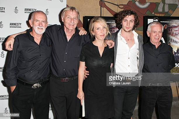 Musician Rod Davis musician Len Garry director Sam TaylorWood actor Aaron Johnson and musician Colin Hanton arrive at the Nowhere Boy special...