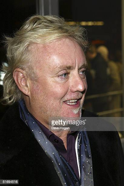 Musician Roger Taylor arrives at the premiere screening of the new fourdisc DVD featuring 10 hours of footage from the historic charity concert Live...