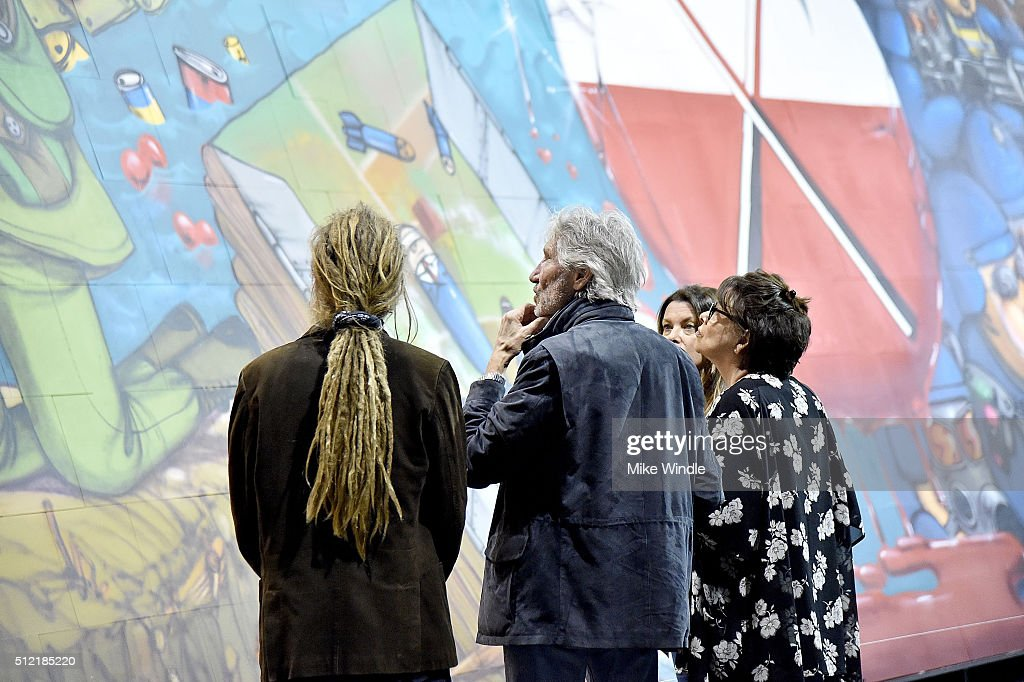 Musician Roger Waters (C) attends in celebration of the release of the Limited Edition box set of the film 'Roger Waters The Wall', Roger Waters hosts Los Angeles Event for Brazilian artists Osgemeos' interpretation of 'The Wall' on February 24, 2016 in Los Angeles, California.