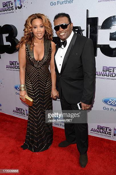 Musician Ronald Isley and Kandy Isley attend the Ford Red Carpet at the 2013 BET Awards at Nokia Theatre LA Live on June 30 2013 in Los Angeles...