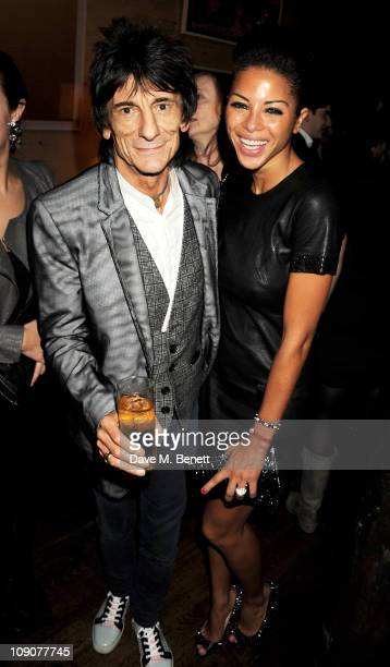 Musician Ronnie Wood and Ana Araujo attend a preBAFTA dinner celebrating best film nominee The King's Speech hosted by The Weinstein Company and...