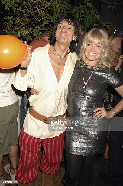 Musician Ronnie Wood and Jo Howard attend the Rolling Stones after show party at Wood's home on August 20 in Kingston England
