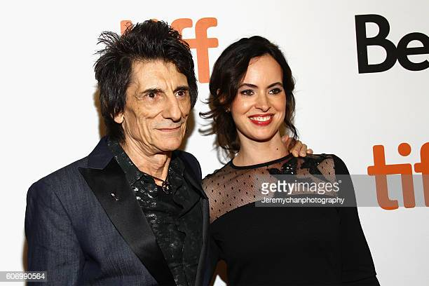 Musician Ronnie Wood and Sally Humphreys attend the 'The Rolling Stones Ole Ole Ole A Trip Across Latin America' premiere held at Roy Thomson Hall...