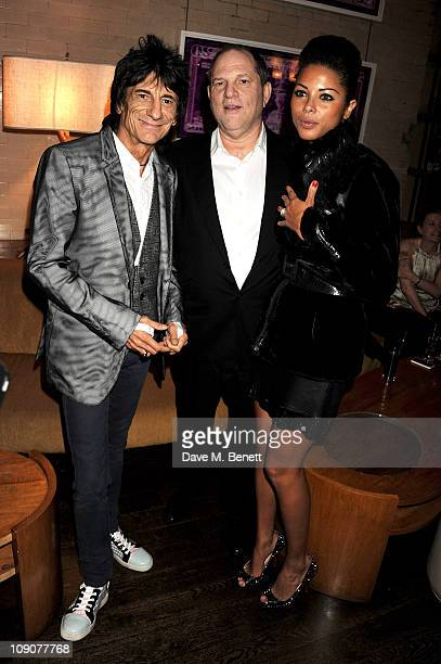 Musician Ronnie Wood Harvey Weinstein and Ana Araujo attend a preBAFTA dinner celebrating best film nominee The King's Speech hosted by The Weinstein...