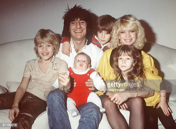 Musician Ronnie Wood poses with girlfriend Jo Howard and children