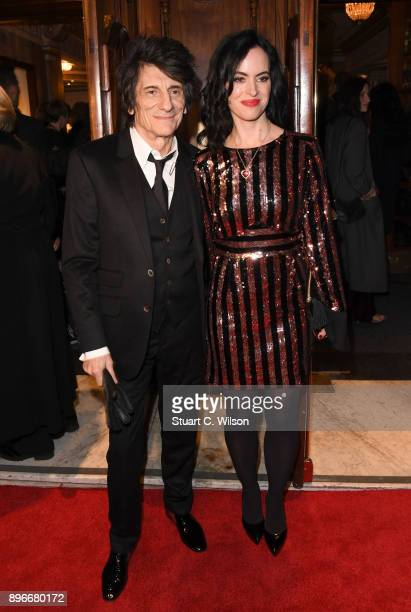 Musician Ronnie Wood with his wife Sally Humphreys attend the opening night of 'Hamilton' at Victoria Palace Theatre on December 21 2017 in London...