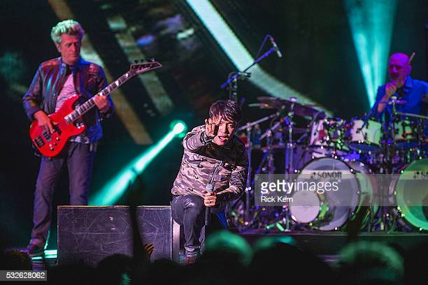 Musician Ross Valory singersongwriter Arnel Pineda and drummer Steve Smith of Journey perform in concert at Austin360 Amphitheater on May 18 2016 in...