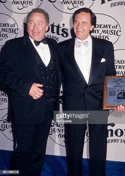 Musician Roy Clark and musician Roger Miller attend the 23rd Annual Academy of Country Music Awards on March 21 1988 at the Good Time Theatre Knott's...