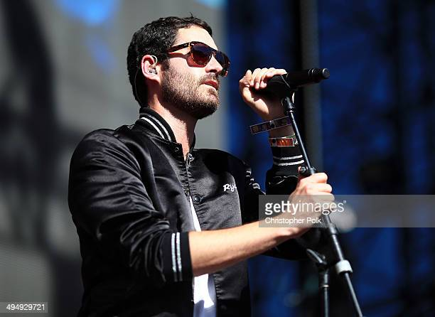 Musician Ryan Merchant of Capital Cities performs onstage during the 22nd Annual KROQ Weenie Roast at Verizon Wireless Music Center on May 31 2014 in...