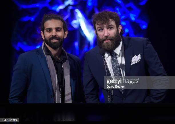 Musician Ryan Patrick of Otherwise and mixed martial artist Michael Chiesa present the Best MMA Programing of the Year award during the ninth annual...