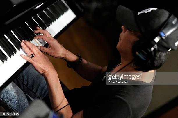 Musician Ryo Okumoto records piano during the Kaylene Peoples My Man Recording Session with Hubert Laws at The Mouse House Studio on April 29 2013 in...