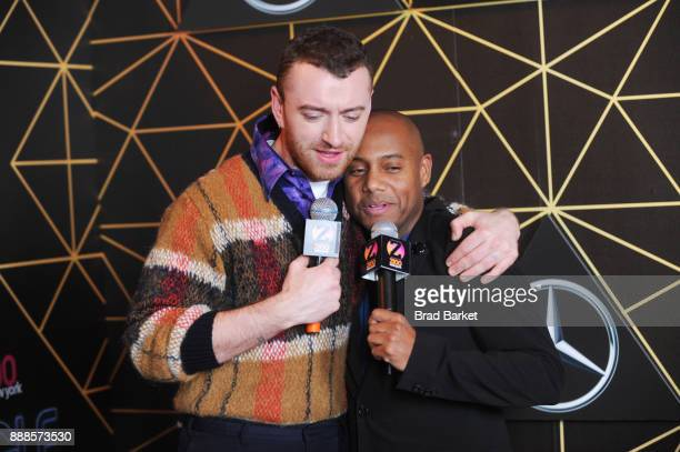 Musician Sam Smith and Maxwell attend the Z100's Jingle Ball 2017 backstage on December 8 2017 in New York City