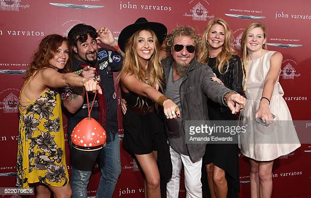 Musician Sammy Hagar his wife Kari Hagar and their family arrive at the John Varvatos 13th Annual Stuart House Benefit presented by Chrysler with...