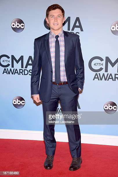 Musician Scotty McCreery attends the 47th annual CMA Awards at the Bridgestone Arena on November 6 2013 in Nashville Tennessee