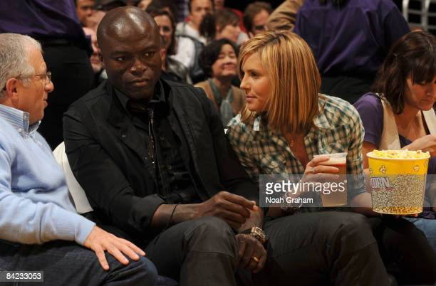 Musician Seal and supermodel Heidi Klum watch a game from courtside between the Indiana Pacers and the Los Angeles Lakers at Staples Center on...