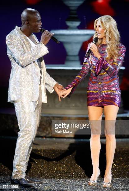 Musician Seal and wife model Heidi Klum kiss on the runway following their performance at the 2007 Victoria's Secret fashion show held at the Kodak...