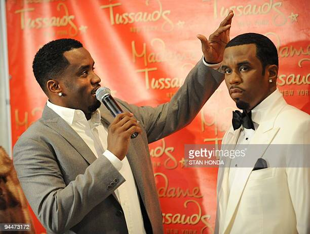 Musician Sean Diddy Combs admires the haircut on a wax figure in his likeness unveiled December 15 2009 at Madame Tussauds New York wax museum AFP...