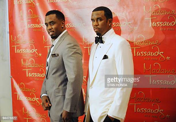 Musician Sean Diddy Combs poses with a wax figure in his likeness unveiled December 15 2009 at Madame Tussauds New York wax museum AFP PHOTO/Stan...