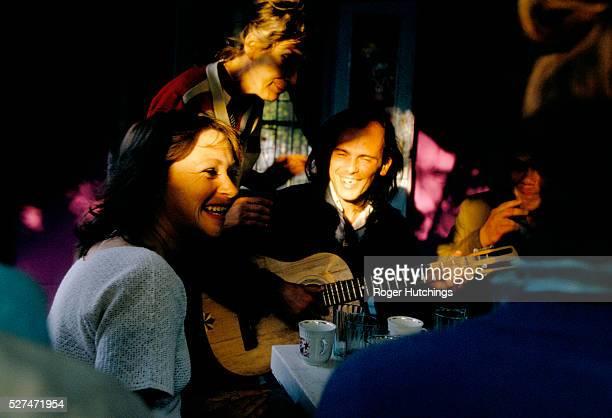 Musician seranading people at a cafe in Simferopol
