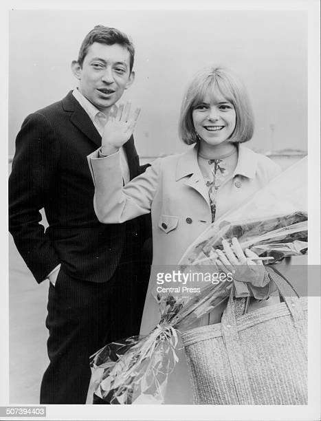 Musician Serge Gainsbourg and singer France Gall winners of the 1965 Eurovision Song Contest arriving at Orly Airport Paris France March 22nd 1965