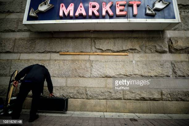 Musician sets up a spot for the day under the sign of Reading Terminal market in Philadelphia PA on September 11 2018