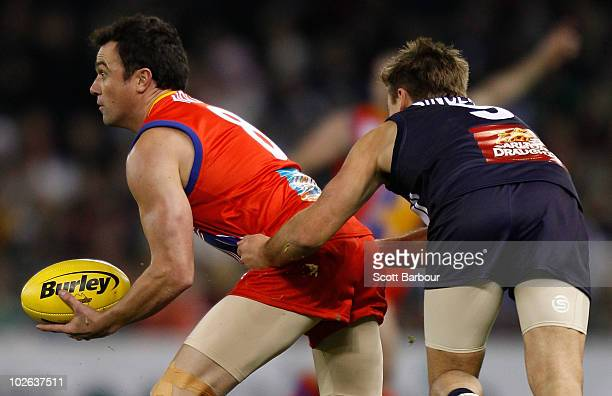 Musician Shannon Noll of the All Stars looks to pass the ball during the 2010 EJ Whitten Legends AFL Game between Victoria and the All Stars at...
