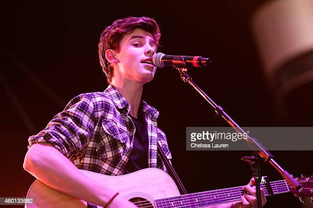 Musician Shawn Mendes performs at KIIS FM's Jingle Ball Village at Chick Hearn Court on December 5 2014 in Los Angeles California