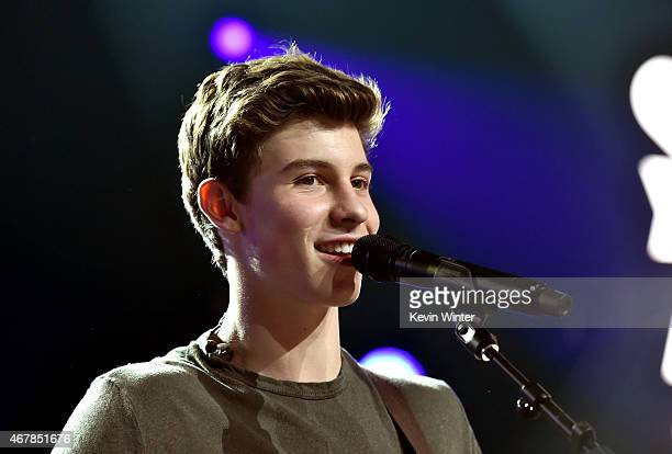 Musician Shawn Mendes performs onstage during iHeartRadio Music Awards Fan Army Nominee Celebration presented by Taco Bell featuring Shawn Mendes at...