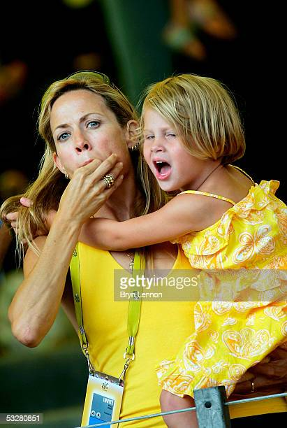Musician Sheryl Crow and Grace Armstrong one of Lance Armstrong's twin daughters cheer on Armstrong of the USA during Stage 21 of the Tour de France...