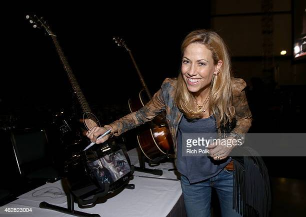 Musician Sheryl Crow attends the Auction Signings at MusiCares Person of the Year during The 57th Annual GRAMMY Awards at the Los Angeles Convention...