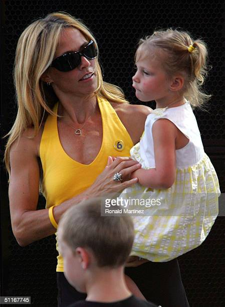 Musician Sheryl Crow holds Lance Armstrong's daughter Grace during a celebration in Armstrong's honor on August 13 2004 in Austin Texas Armstrong has...