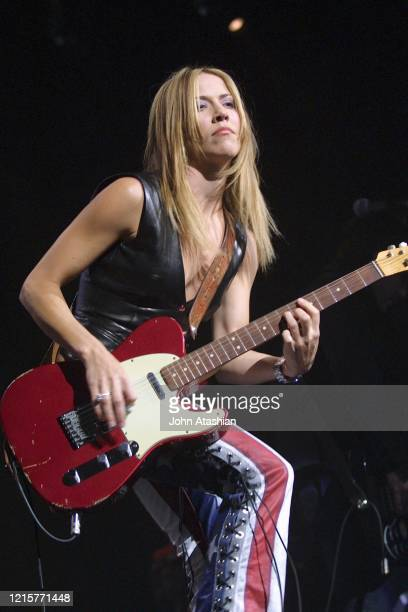 """Musician Sheryl Crow is shown performing on stage during a """"live"""" concert appearance on September 1, 2002."""