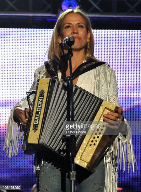 Musician Sheryl Crow performs at the 2010 MusiCares Person Of The Year Tribute To Neil Young at the Los Angeles Convention Center on January 29, 2010...
