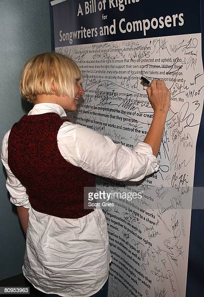 Musician Sia signs a poster at the Tribeca ASCAP Music Lounge held at the Canal Room during the 2008 Tribeca Film Festival on May 1, 2008 in New York...