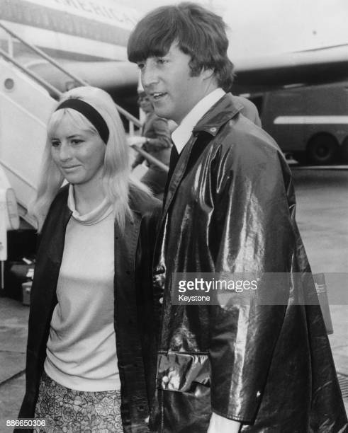 Musician singer and songwriter John Lennon of British rock group the Beatles and his first wife Cynthia arrive home at London Airport after a holiday...