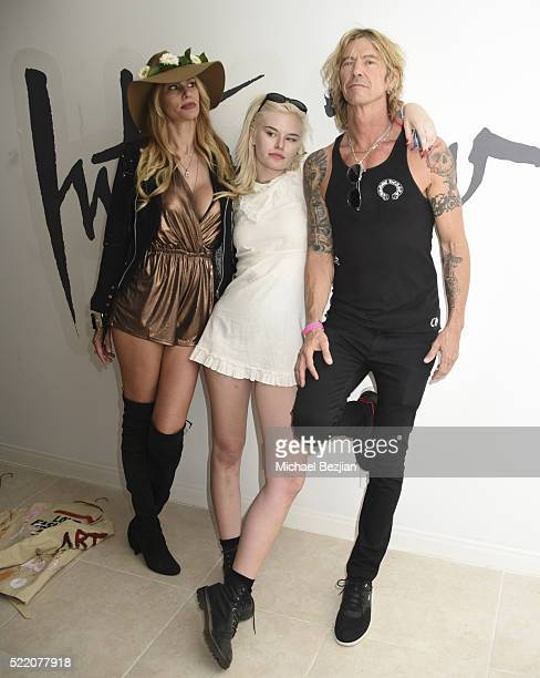 Musician singer songwriter and author Duff McKagan model television personality and fashion designer Susan HolmesMckagan and singer Grace 'Grave'...