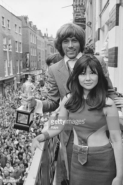 Musician singer songwriter and record producer Barry Gibb is awarded a statuette by ChineseBritish actress Tsai Chin after being voted best dressed...