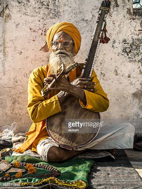 Musician singing and playing music at Udaipur India