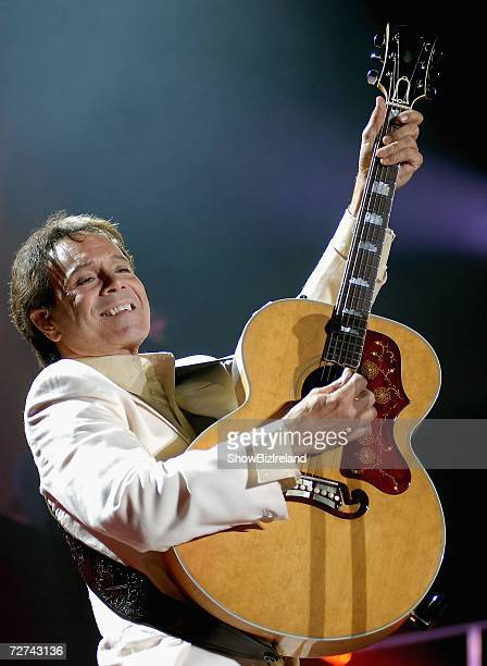 Musician Sir Cliff Richard performs live on stage at The Point Theatre on December 5, 2006 in Dublin, Ireland.