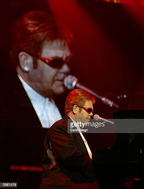Musician Sir Elton John performs on stage during the Andre Agassi Foundation's 8th Annual Grand Slam for Children benefit concert at the MGM Grand...
