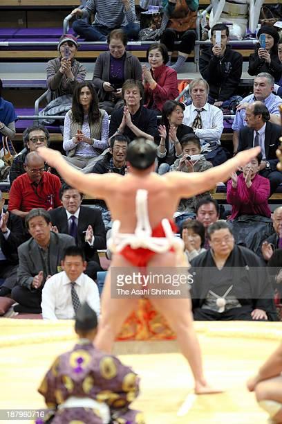 Musician Sir Paul McCartney and his wife Nancy Shevell watches 'DohyoIri' purification ritual by yokozuna sumo grand champion Harumafuji during day...