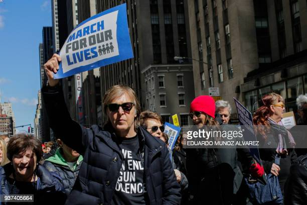Musician Sir Paul McCartney takes part in the March for Our Lives Rally near Central Park West in New York on March 24 2018 Huge crowds of Americans...