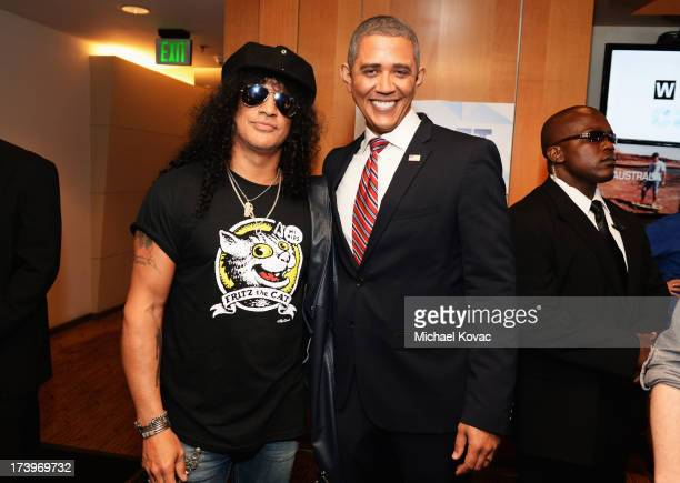Musician Slash and actor Reggie Brown attend day 1 of the WIRED Cafe at Comic-Con on July 18, 2013 in San Diego, California.