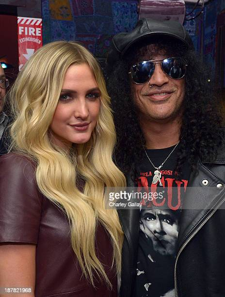 Musician Slash and actress/singer Ashlee Simpson attend the BandFuse Rock Legends video game launch event at House of Blues Sunset Strip on November...