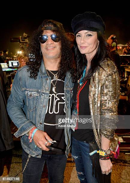 Musician Slash and Meegan Hodges attend Desert Trip at The Empire Polo Club on October 15 2016 in Indio California
