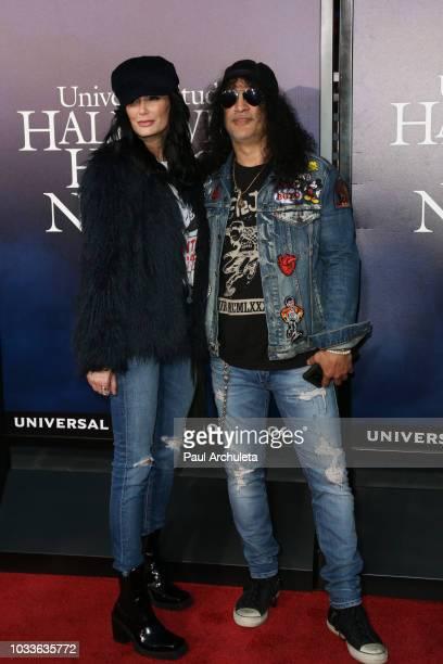 "Musician Slash and Meegan Hodges attend the opening night celebration of ""Halloween Horror Nights"" at Universal Studios CityWalk Cinemas on September..."