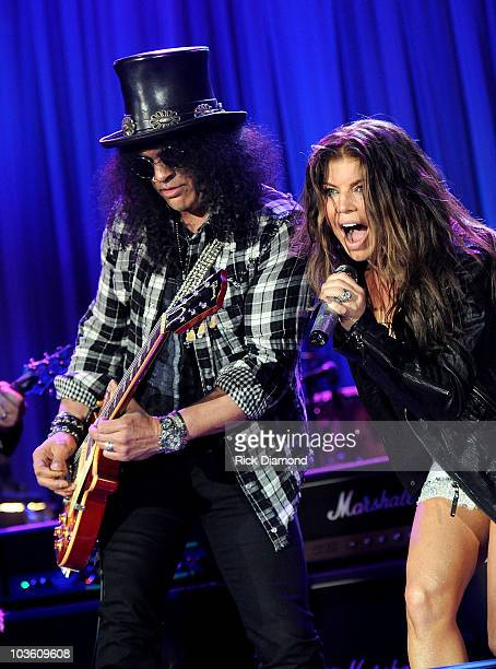 Musician Slash and singer Fergie onstage during the 52nd Annual GRAMMY Awards Salute To Icons Honoring Doug Morris held at The Beverly Hilton Hotel...