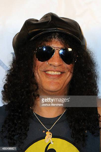 Musician Slash arrives at the Avalon for Kings of Chaos Tokyo Celebrates The Dolphin Benefit Concert on November 18, 2013 in Hollywood, California.