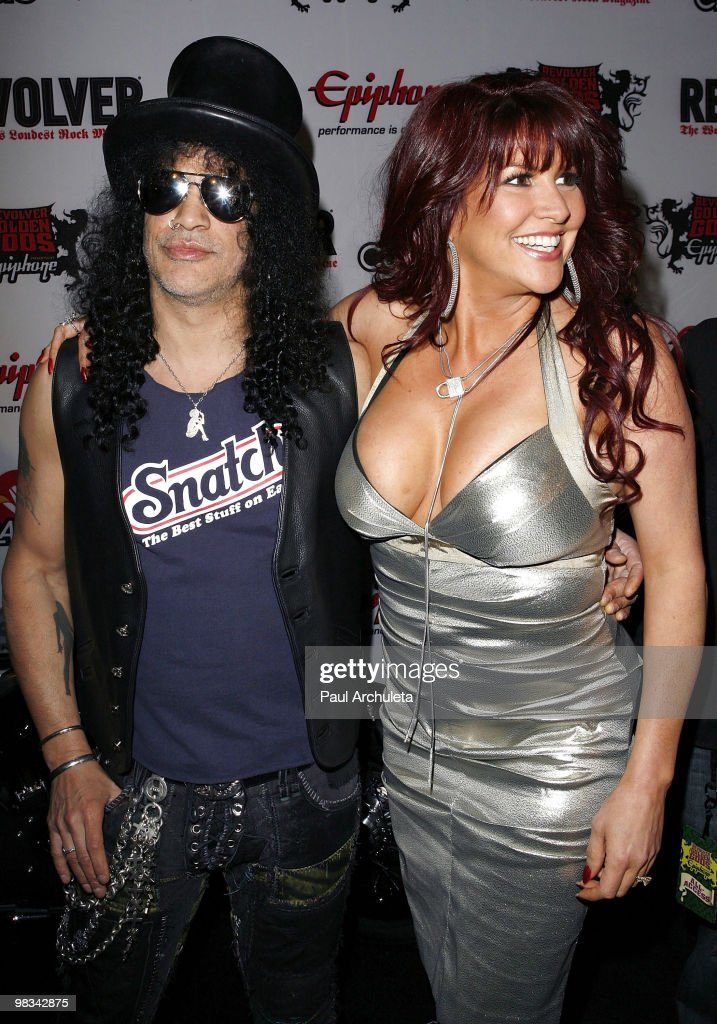 Musician Slash & his wife Perla Ferrar arrive at the 2nd annual Revolver Golden Gods Awards at Club Nokia on April 8, 2010 in Los Angeles, California.